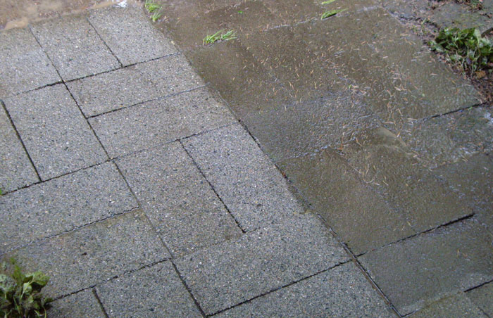 pressure washing walkway stones showing difference before and after the cleaning