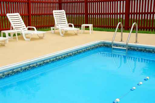 swimming pool deck area with furniture